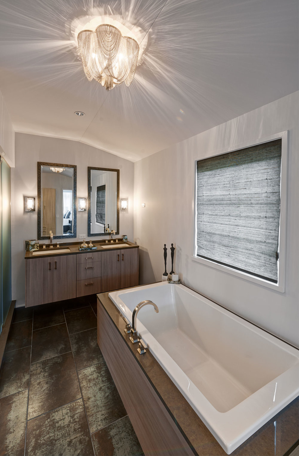 Fort Sheridan Ranch - Master Bathroom   Italian porcelain flooring in large 12 x 24 staggered pattern. Vanity and tub surrounded in a custom wood finish. Overhead chain light fixture and three sconces provide beautiful lighting.