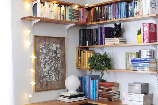 I love these book shelves on the corner!!! looks great and the lighting is an extra bonus!
