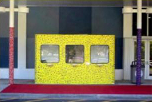 "Partial View of ""Wrapping Ying-Yang"". Installation. Mixed media on canvas wrapping ticket booth and columns."