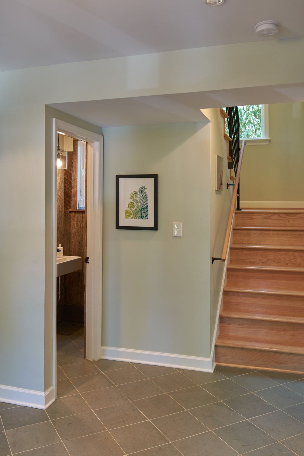 Entry hall with powder room under stair
