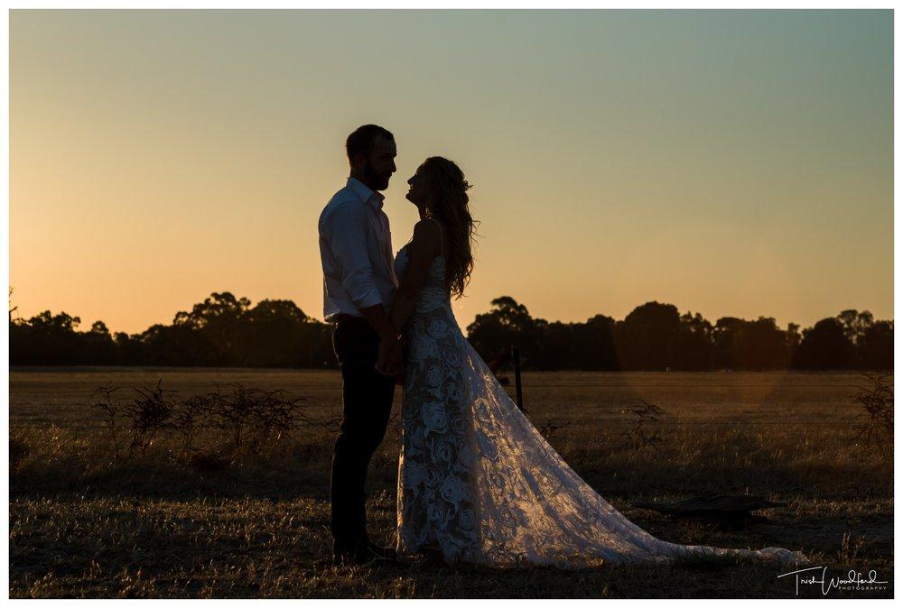Sunset silhouette wedding portrait