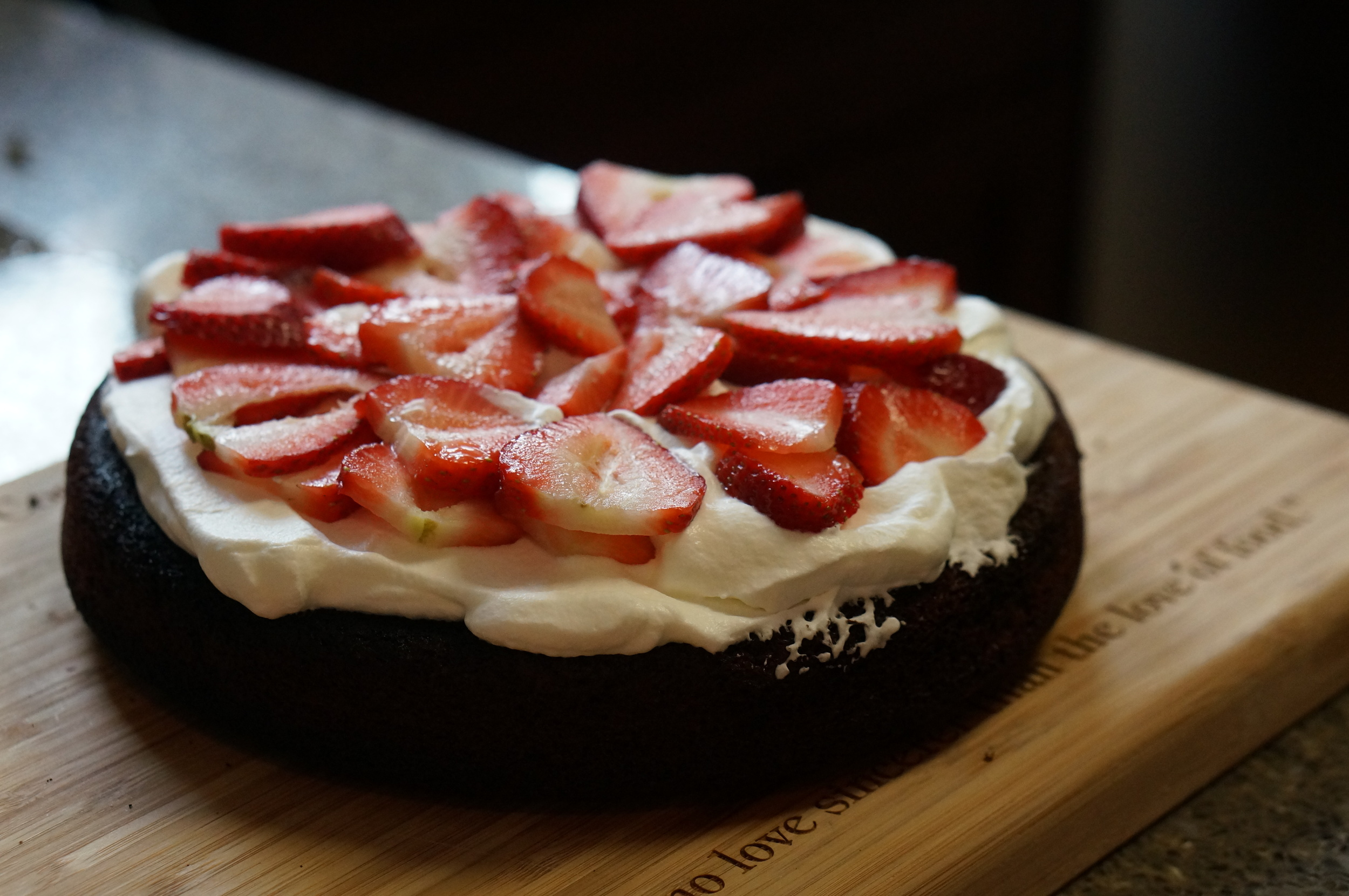 Chocolate Cake Filled with Whipped Cream and Fresh Strawberries