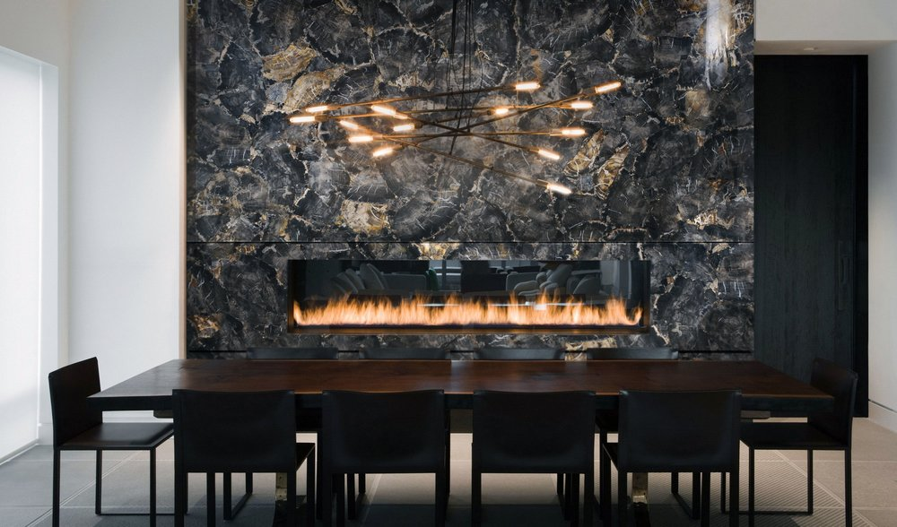 Black Petrified Wood cladding to fireplace - Cladding available through Zuccari Stone