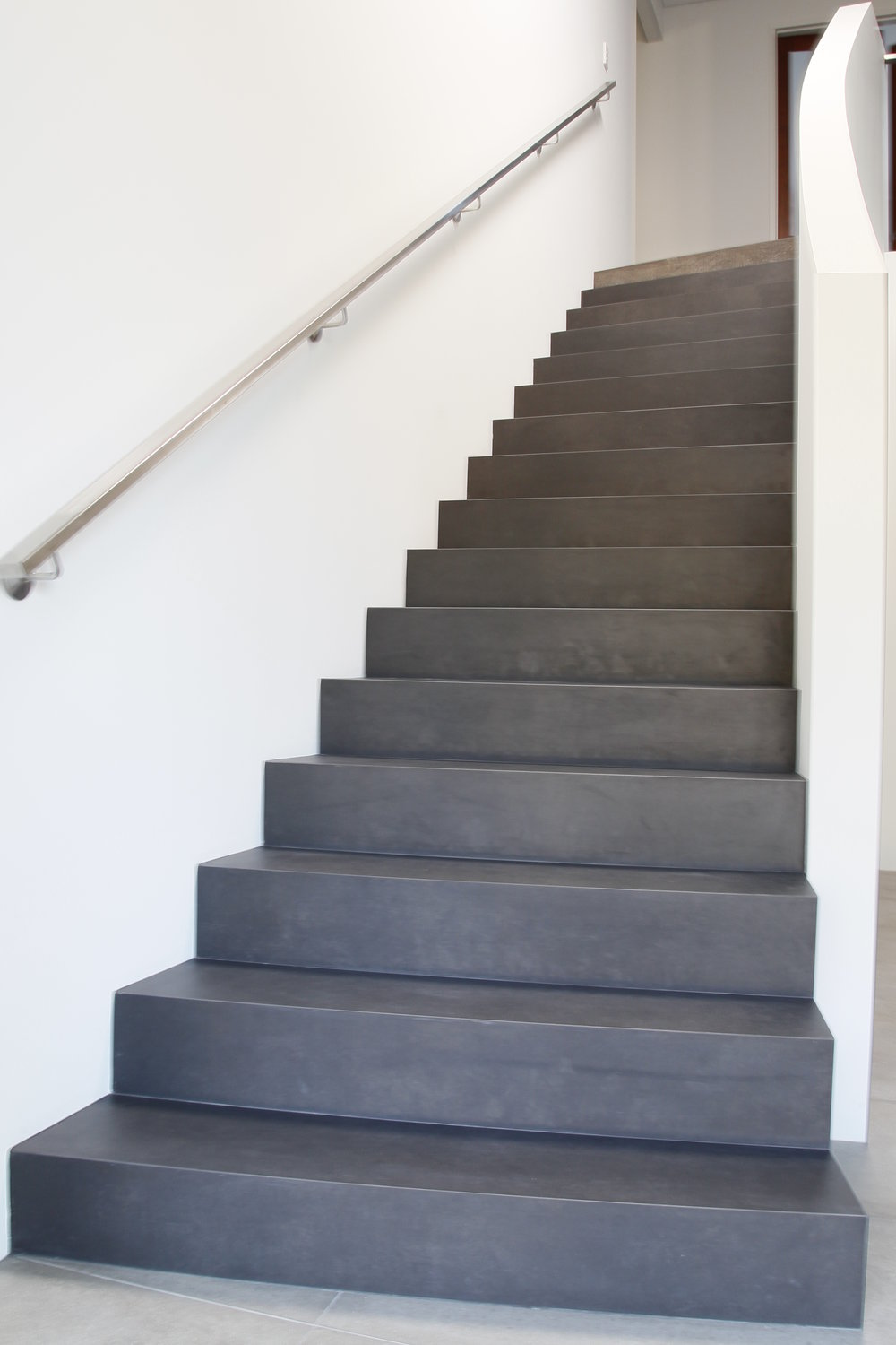 Want your stairs tiled but don't want the grout lines? Look no further!