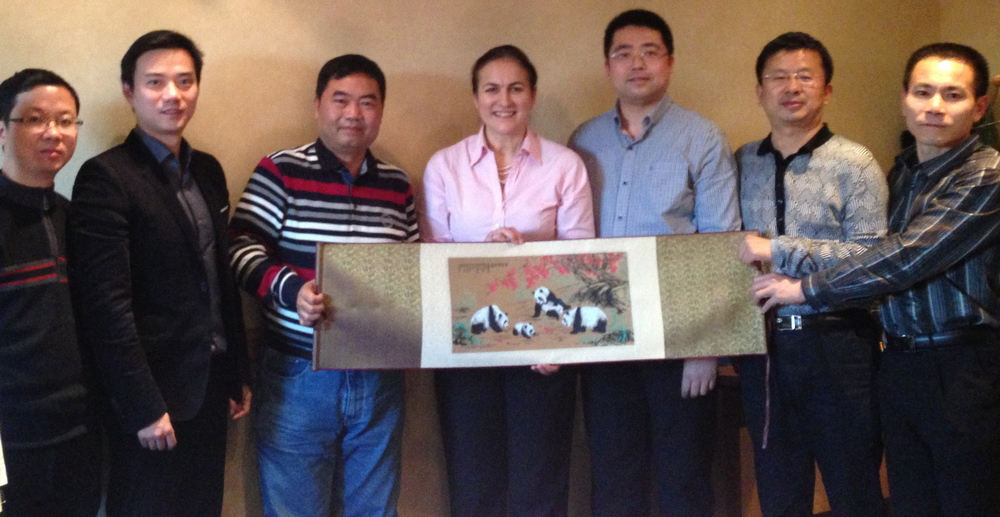 The delegates present me with a Shu Brocade panel from their home city of Chengdu