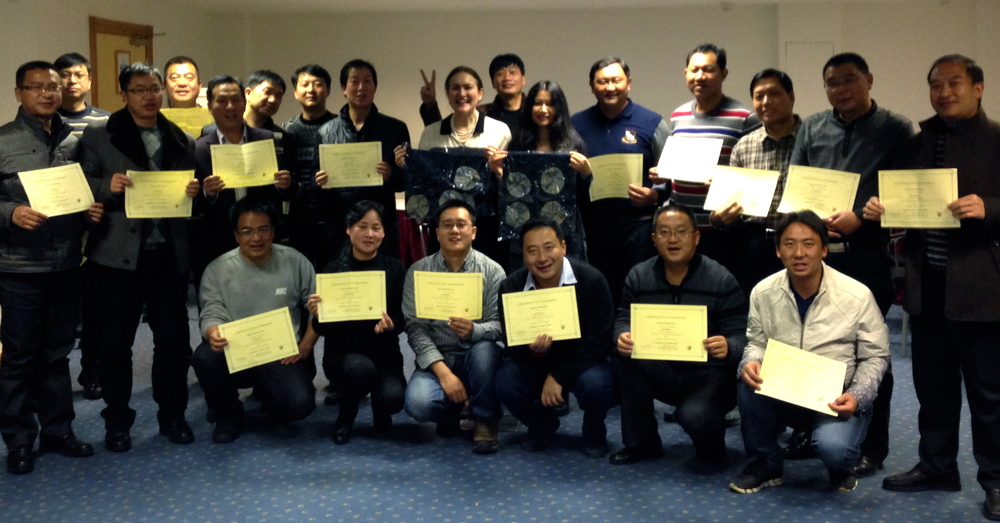 My Chinese bankers with their certificates and sense of humour (well, certainly the guy standing behind me!)
