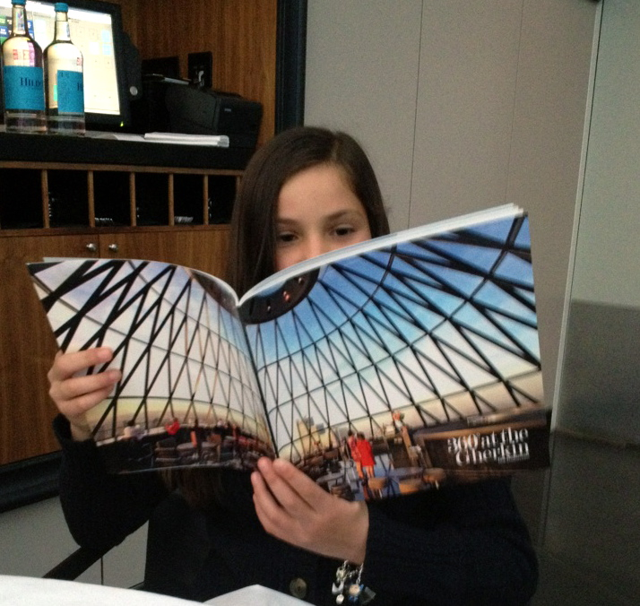 A special guest enjoys reading her copy of  '360˚ at the Gherkin'