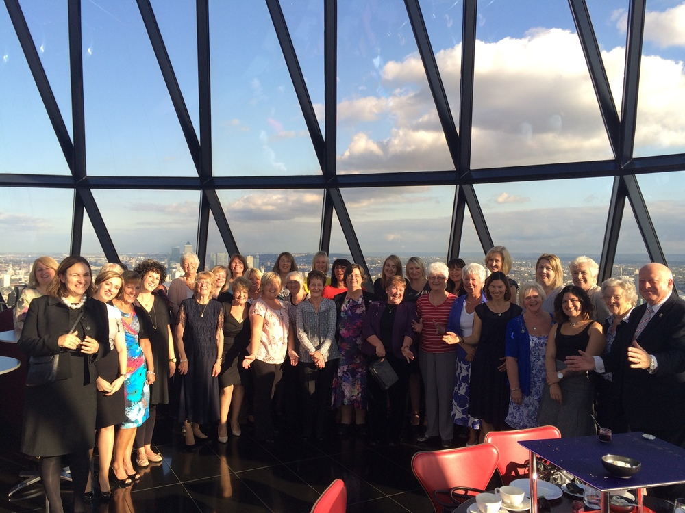 The wives, partners and daughters of the City of London's Beadles at the Gherkin, with Yeoman Warder Colin Smith