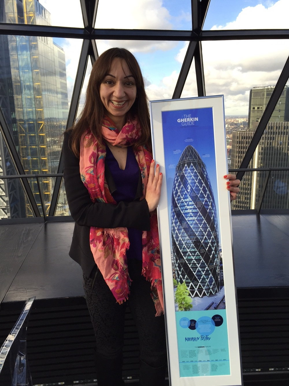 Barinder, the 2014 NSPCC Gherkin Challenge top individual fundraiser receiving her signed print