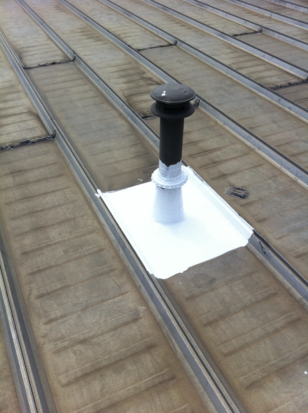 leaking metal roof stack sealed on a standing seam roof.