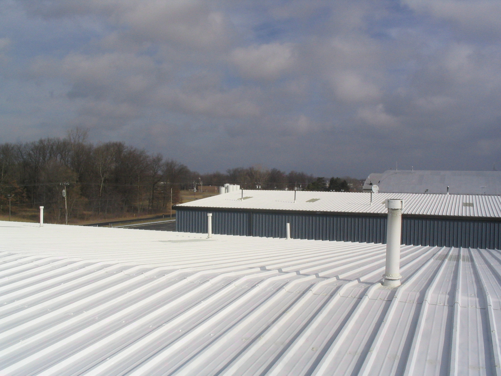 Elastomeric roof coating was applied   after these metal roofs were waterproofed.  Aircraft hangars, Toledo, OH.