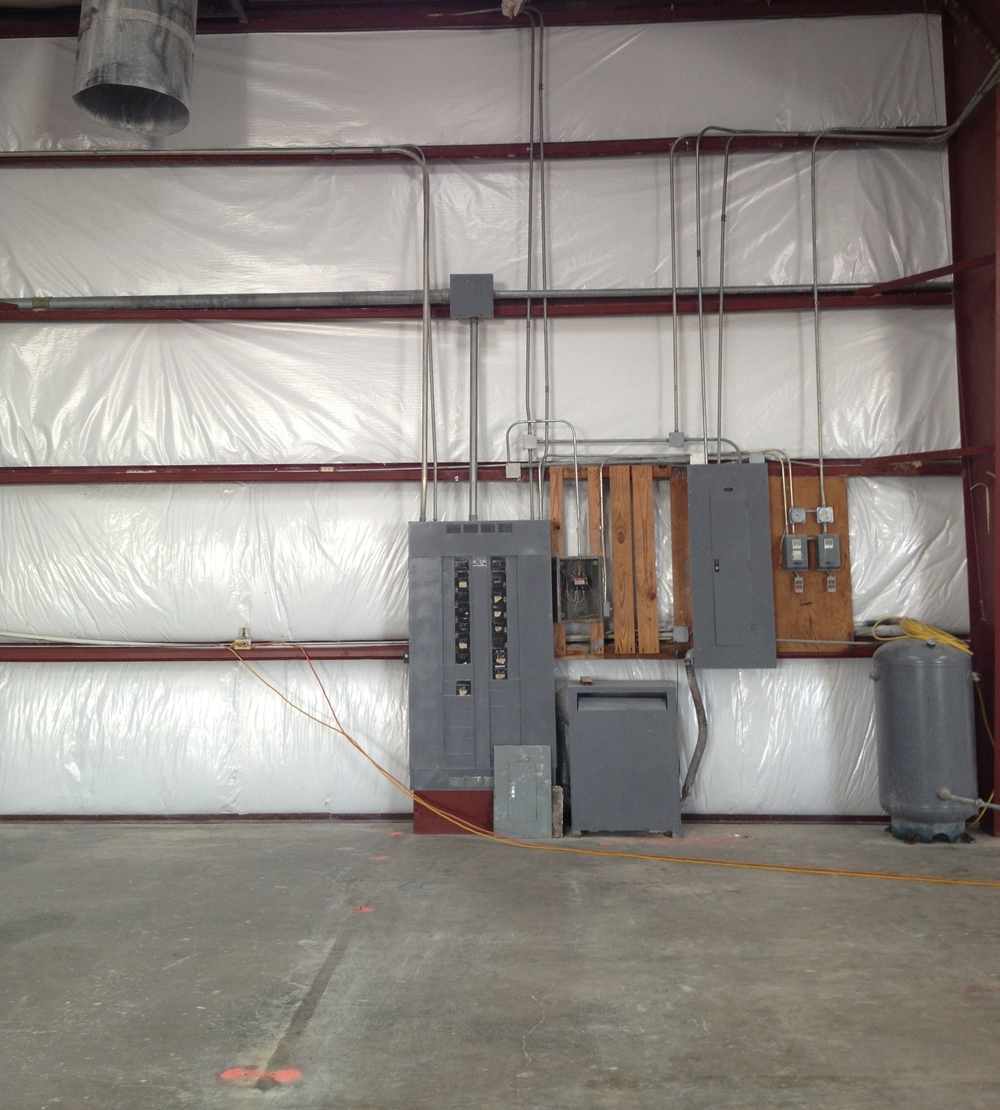Damaged metal building insulation repaired
