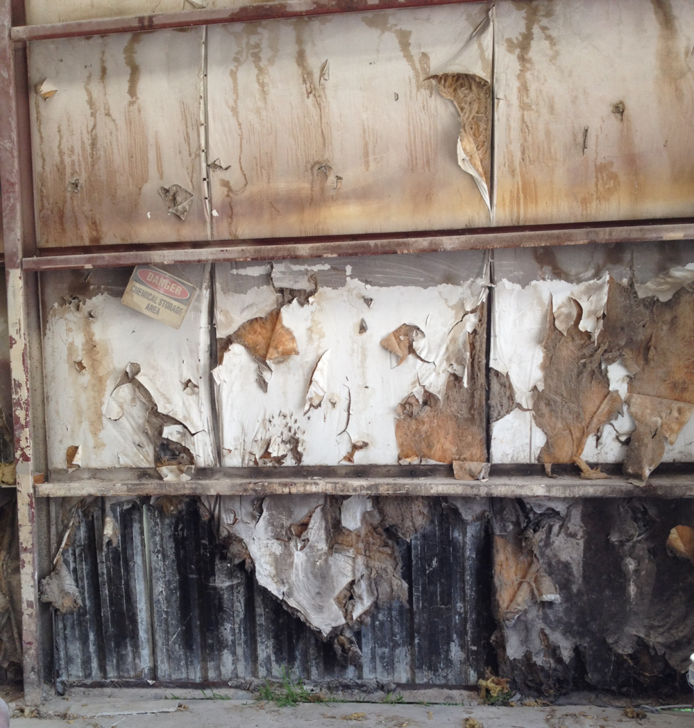 Before the repair, this metal building insulation was damaged.