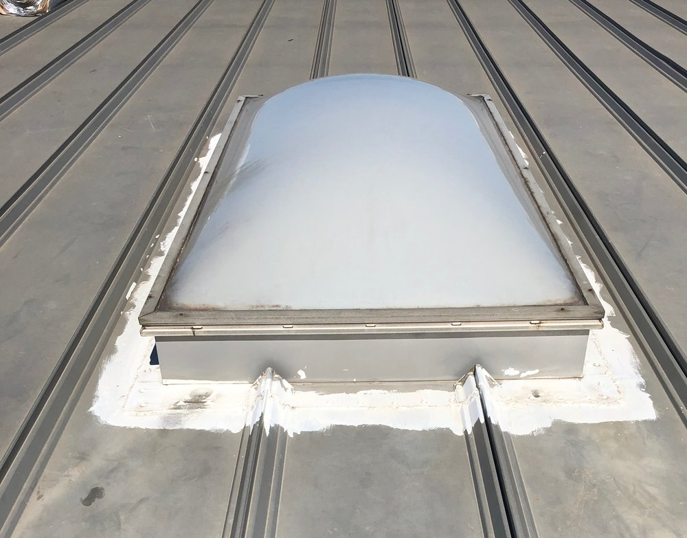 Before, a metal roof skylight the building owner wanted removed.