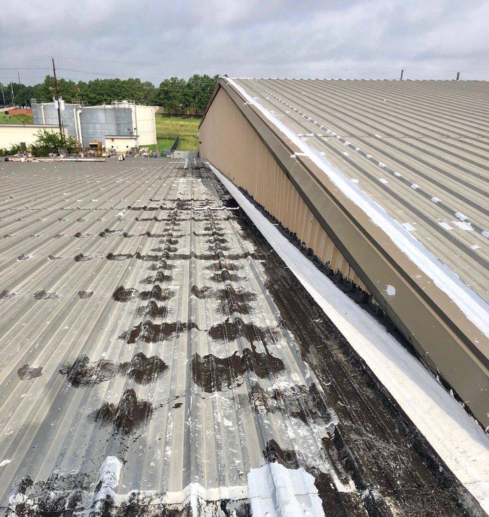 Metal roof before cut and paste repair