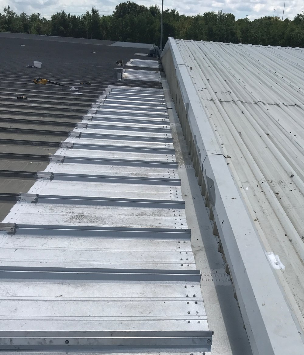We replace the rotted out standing seam roof panels at the eave and also replaced the internal gutter.