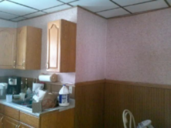 Our kitchen wallpaper, wainscoting and all.