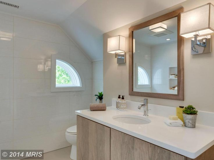 wood and white bathroom, sconces