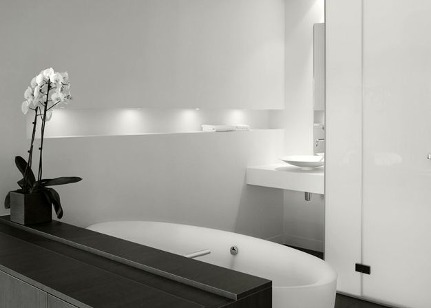 egg shaped bath, clean lines, orchids.