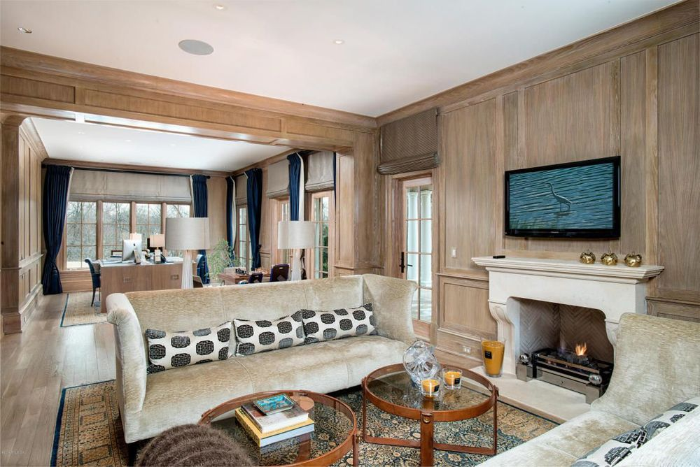 warm and cozy wood paneling in the home office and sitting room