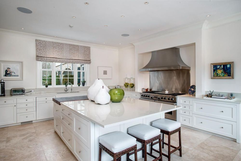 clean traditional kitchen with great island and beautiful range hood