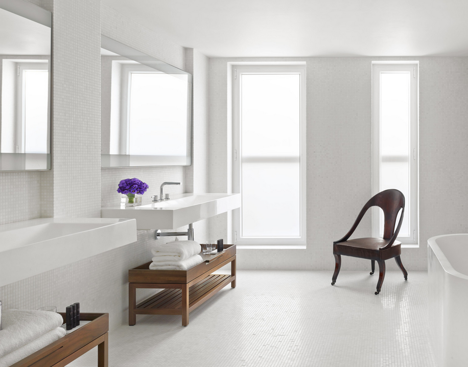Clean and minimal bathroom. Natural light, floating vanities.