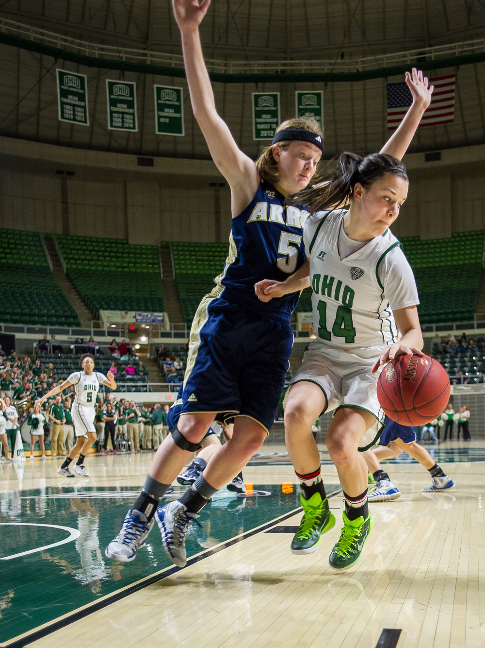 Ohio University Women's Basketball player Kat Yelle, of Geneva, Illinois, attempts to score amidst the guarding tactics of University of Akron freshman Kerri McMahan, of Novi, Michigan. The Bobcats pulled off a win 72-60 against the Zips at the Convocation Center in Athens, Ohio, on January 28, 2015.