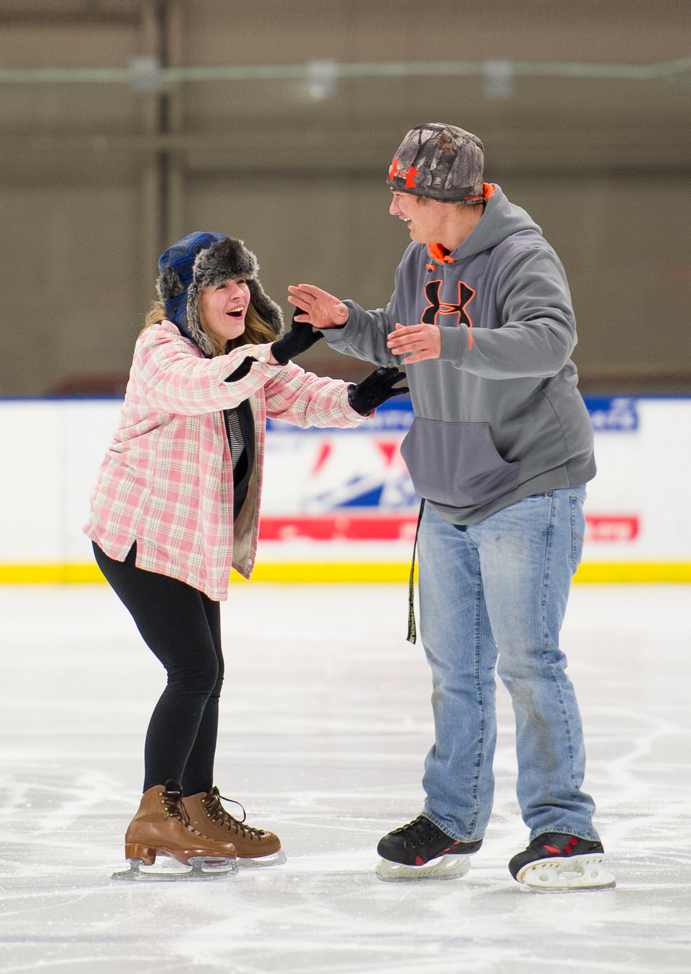 Keira Mccourt, 16, of Meigs County, Ohio, and Wyatt Hart, 17, of Coolville, Ohio, share a moment of laughter together after falling on the ice. On January 28, 2015, the two teens came to Bird Arena in Athens, Ohio to spend the evening at the recreational skate event with a group of their friends.
