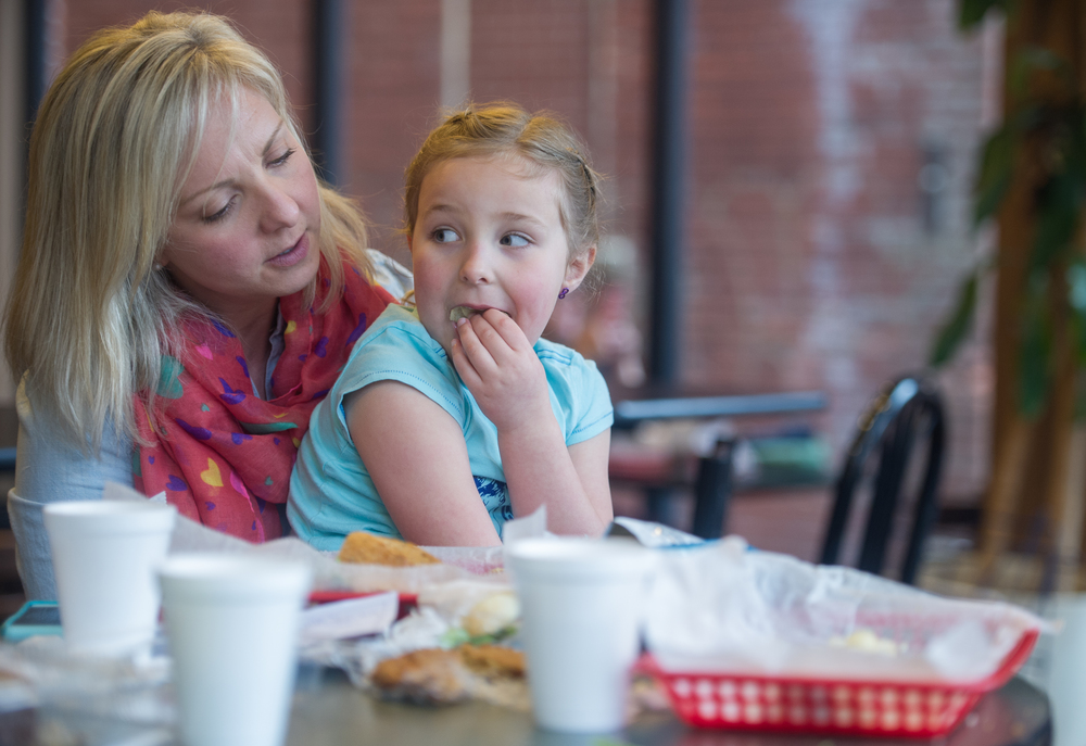 Mandi Rodgers and her daughter Reese Rodgers, 5, of Athens, Ohio, enjoy lunch at Brenen's Coffee Cafe on April 2, 2015 in Athens, Ohio. Rodgers and her kids are enjoying their spring break at the cafe after spending the day making ice cream at their home. (©2015 Sarah Stier)