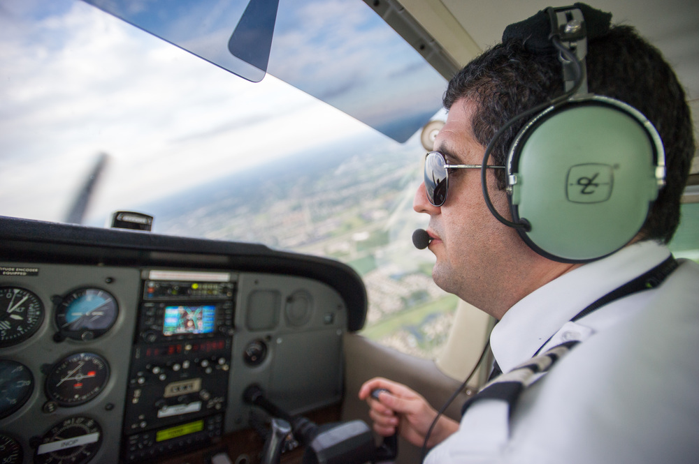 """Reda Elidrissi of Dayton, Ohio, flies a Cessna 172RG at the annual Runway Fest held by Dayton-Wright Brothers Airport on August 7th, 2015, in Miamisburg, Ohio. Elidrissi has been flying for seven years and currently works as a flight instructor at the Wright Brothers Airport. """"Don't ever work,"""" Elidrissi says. """"Because if you're doing what you truly love, then it is never work."""" (©Sarah Stier 2015)"""