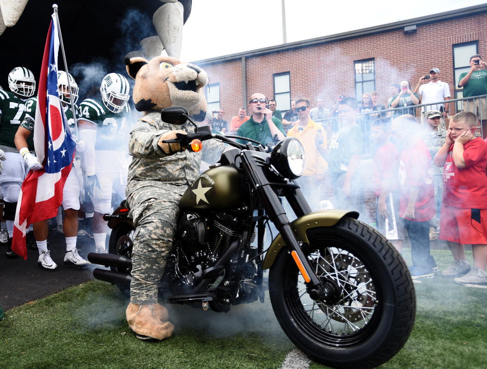 Led by Ohio University mascot Rufus the Bobcat, the Ohio University football team prepares to make their entrance onto the field before the Bobcats' game against Southeastern Louisiana University on September 19, 2015, at Peden Stadium in Athens, Ohio.