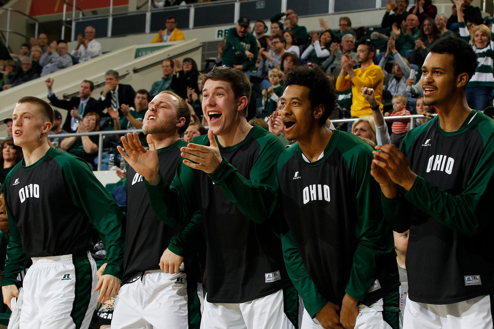 "Ohio Bobcats players react to points scored during the game. The Ohio Bobcats bench was featured on ESPN earlier this month as giving competition to ESPN's current ""best bench in basketball,"" the Monmouth Hawks. ©2016 Sarah Stier 