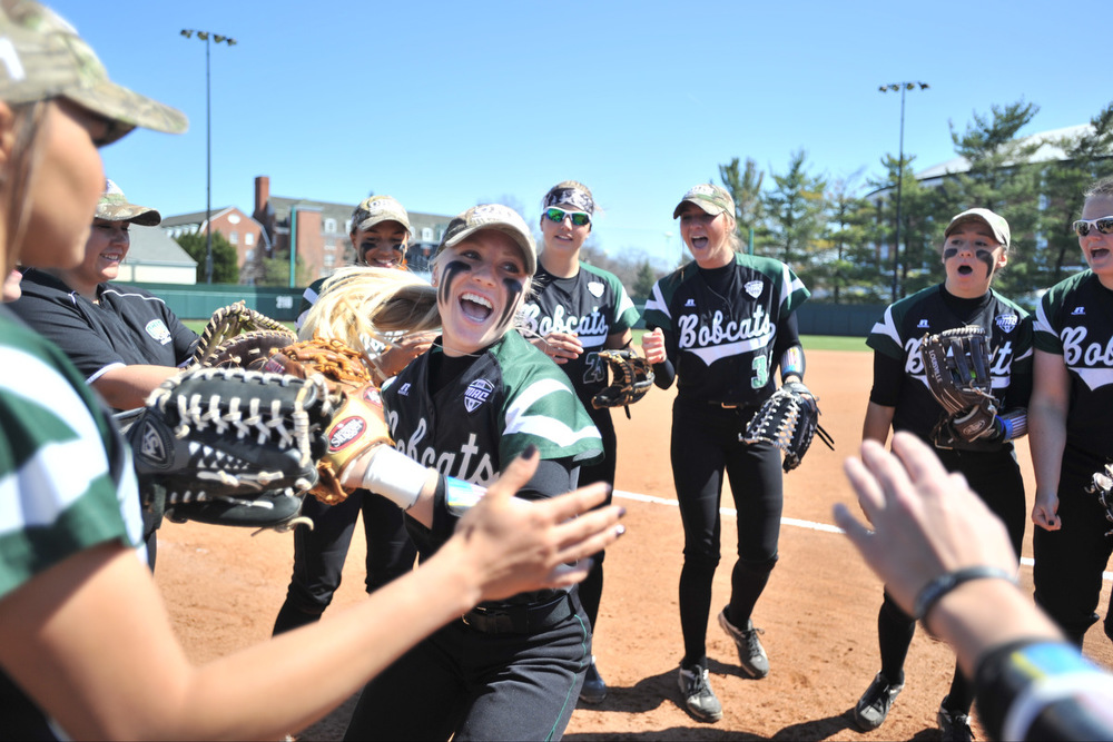 Ohio University sophomore Taylor Saxton high-fives her teammates as she is introduced before the Bobcats' game against Western Michigan on March 26, 2016, in Athens, Ohio. The Bobcats won the three-game series that weekend. ©2016 Sarah Stier | Ohio Athletics