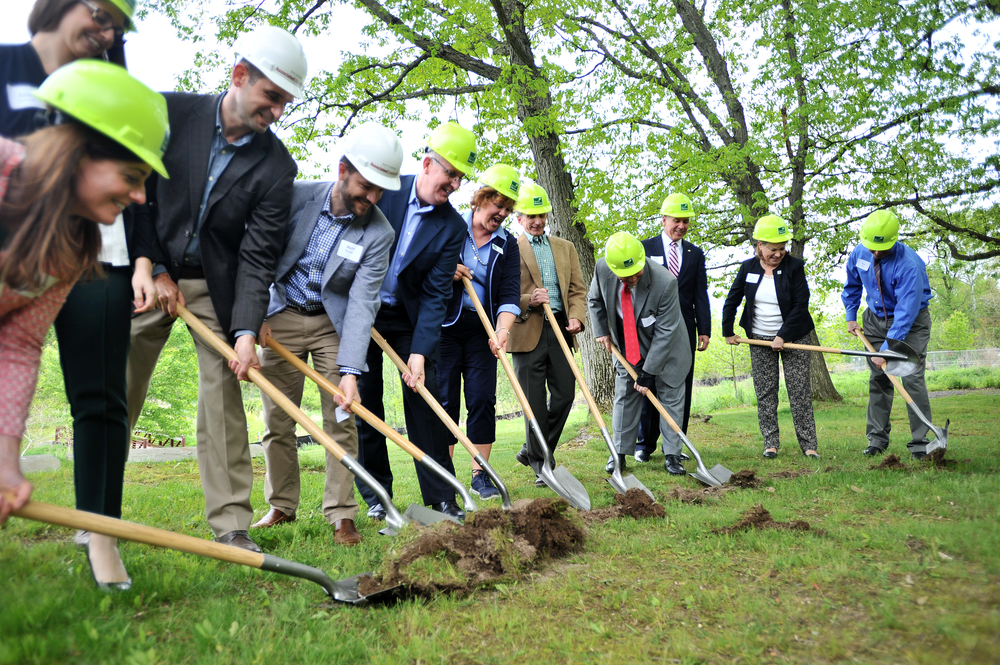 Members of the Berks Nature board and representatives from various planning agencies break ground during a ceremony held on May 18, 2016, to mark the start of building Berks County's new nature center in Reading, Pennsylvania.