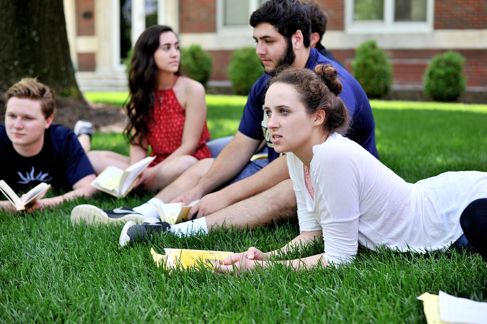 "Ali Speiss discusses a portion of ""A Passage to India"" with her classmates during their senior Honors English Class at Wyomissing High School on May 23, 2016, in Wyomissing, PA. Sam Gust, Amanda Bollinger, and Paul Feightner are pictured in the background. (Reading Eagle: Sarah Stier)"