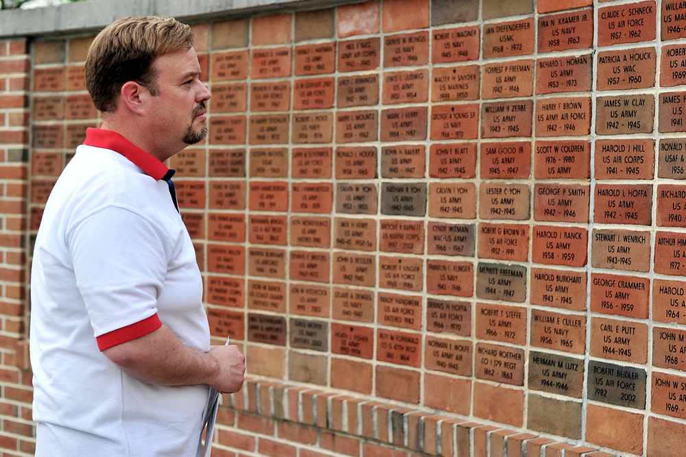 Mike Semery, of Ontelaunee Township, reads names on the wall of veterans at the Veterans' Memorial Ceremony on May 26, 2016, in Robesonia, PA. (Reading Eagle: Sarah Stier)