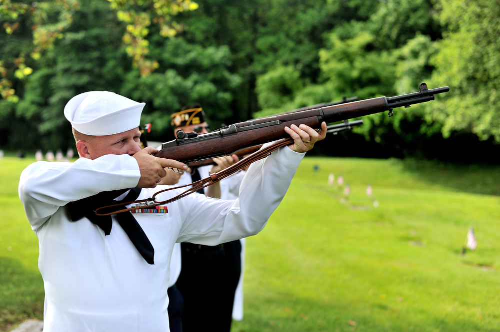 Darren Packer, member of VFW Post 6150, prepares for the gun salute at the Sinking Spring VFW service in Sinking Spring Township, PA, on May 30, 2016. (Reading Eagle: Sarah Stier)
