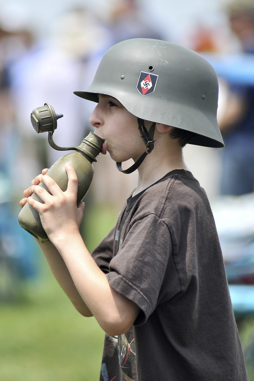 Eddie Rowell, 8, drinks water out of a canteen at the World War II Weekend in Reading, PA, on June 4, 2016. (Reading Eagle: Sarah Stier)