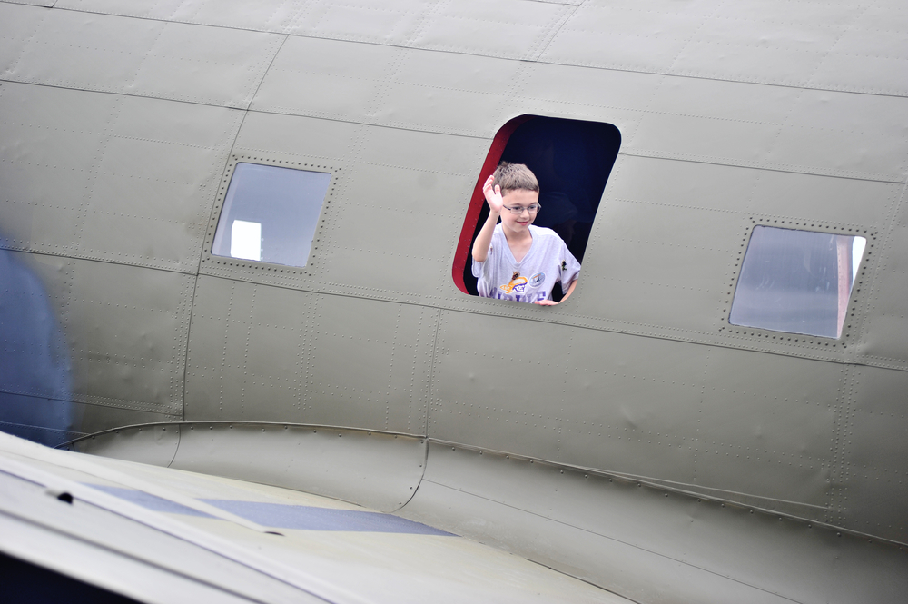 Kael Koval, 9, of Ephrata, PA, peeks out the window of a bomber at the World War II Weekend in Reading, PA, on June 3, 2016. (Reading Eagle: Sarah Stier)