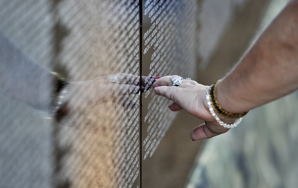 Linda Kostan of Muhlenberg searches for a name on the wall at the Opening Ceremony for the Vietnam Memorial Moving Wall in Muhlenberg, PA, on June 9, 2016. (Sarah Stier: Reading Eagle)