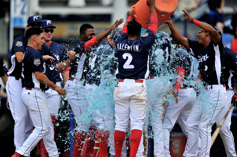 Players celebrate after the Fightin' Phils win over the Akron Rubberducks at FirstEnergy Stadium in Reading, PA, on June 23, 2016. (Reading Eagle: Sarah Stier)