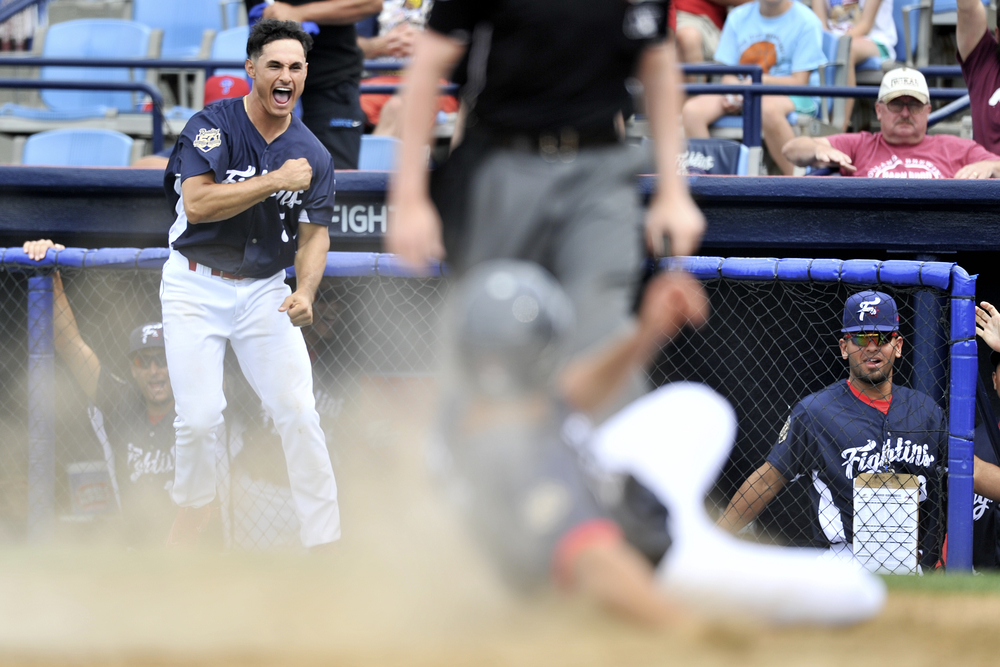 KC Serna celebrates in the background as Dylan Cozens slides into home, winning the game for the Phils during the Fightin' Phils baseball game against the Akron Rubberducks at FirstEnergy Stadium in Reading, PA, on June 23, 2016. (Reading Eagle: Sarah Stier)