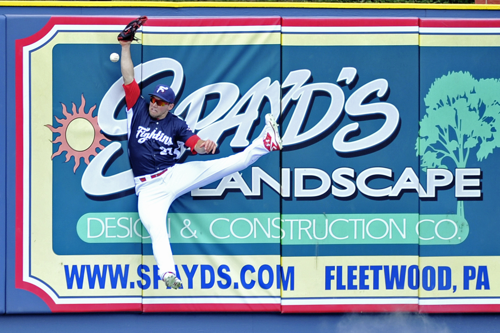 Aaron Brown jumps to make a catch during the Fightin' Phils baseball game against the Akron Rubberducks at FirstEnergy Stadium in Reading, PA, on June 23, 2016. (Reading Eagle: Sarah Stier)