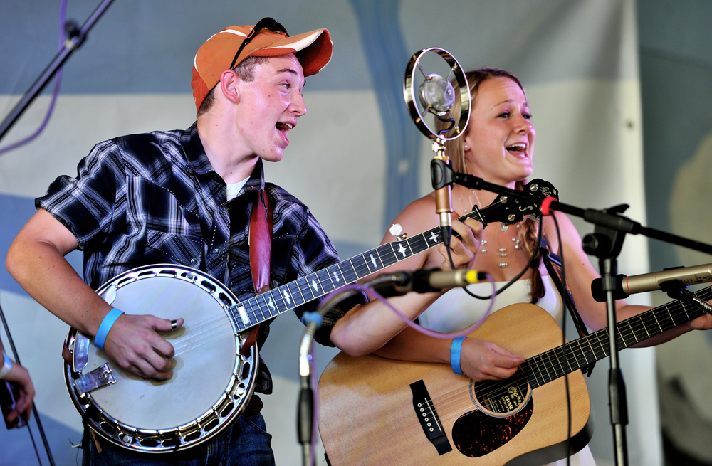 "Conlan Kerschner of Adamstown, PA, performs a cover of ""You Are My Sunshine"" with fellow band-member Maegan Weinhold of Denver, PA, during the single-mic band competition at Mountain Folk Fest in Ruscombmanor Township, PA, on June 19, 2016. (Reading Eagle: Sarah Stier)"