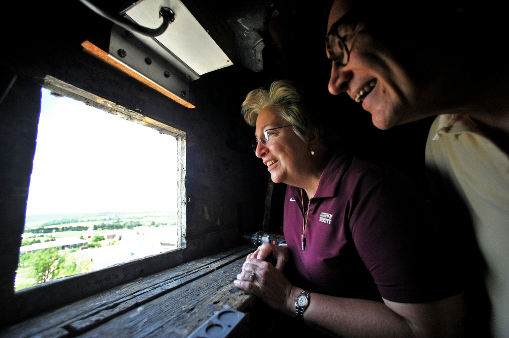 Susan Pichini of Wyomissing and Guido Pichini, chairman of the state board of governors of state universities, get a view of campus from the belltower during the Pilgrimage to the Tower of Old Main at Kutztown University in Kutztown, PA, on June 22, 2016. The Pilgrimage was held in celebration of the university's 150-year anniversary. (Reading Eagle: Sarah Stier)