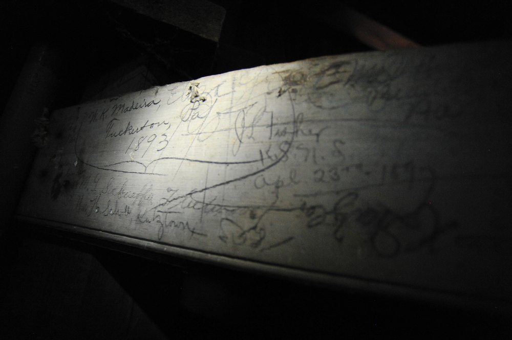 Though students are no longer allowed up inside, signatures on the rafters of Old Main's belltower dating back to the 1890s can be seen during the Pilgrimage to the Tower of Old Main at Kutztown University in Kutztown, PA, on June 22, 2016. The earliest found was from 1893.