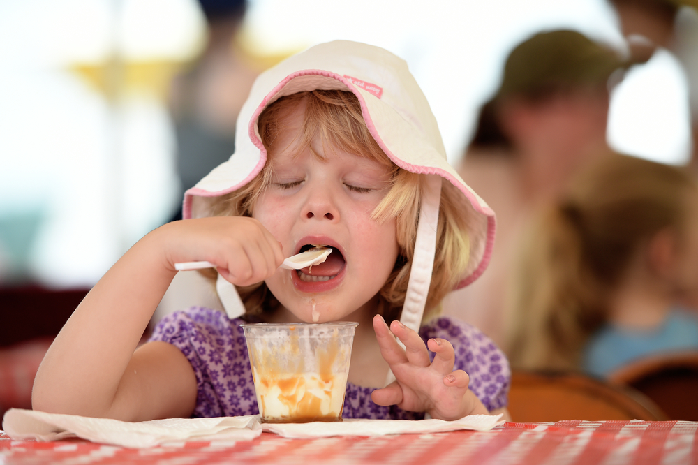 Asha Hostetter, 3, of Columbus, Georgia, enjoys banana ice cream at the Kutztown Folk Festival in Kutztown, PA, on July 7, 2016. (Reading Eagle: Sarah Stier)