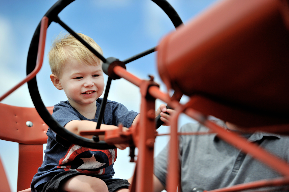 Ethan Gallagher, 2, of Coopersburg, PA, grips the wheel of a tractor at the Kutztown Folk Festival in Kutztown, PA, on July 2, 2016. (Reading Eagle: Sarah Stier)