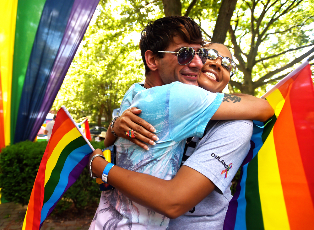 Michael Creel (left) and Carmen Calderon of Reading share a hug at the Reading Pride Festival at Centre Park in Reading, PA, on July 17, 2016. (Reading Eagle: Sarah Stier)