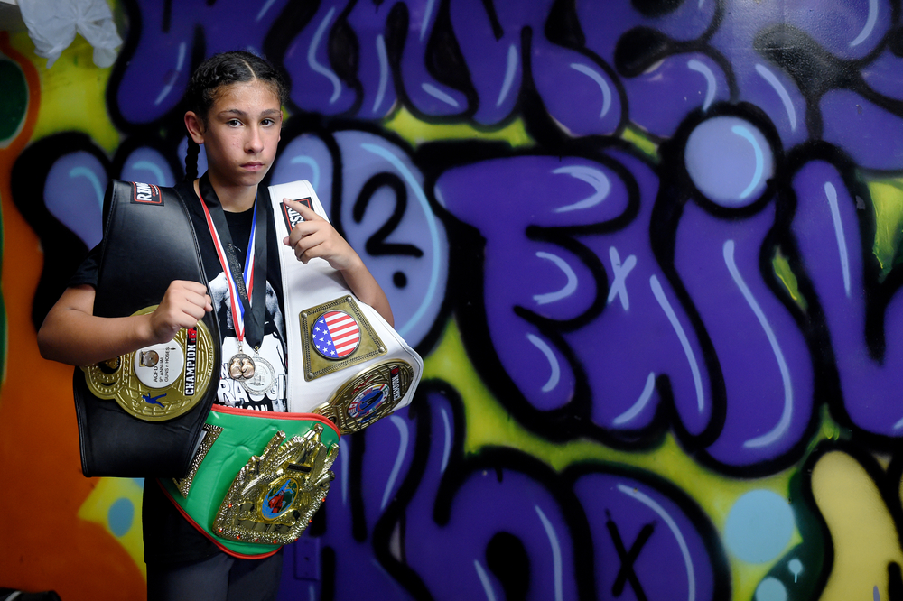 Faith Mendez, 12, of Reading poses for a portrait at Almighty Boxing Club in Reading, PA, on July 18, 2016. Mendez was a bronze medalist at the 2016 National Junior Olympics in Dallas, TX. (Reading Eagle: Sarah Stier)